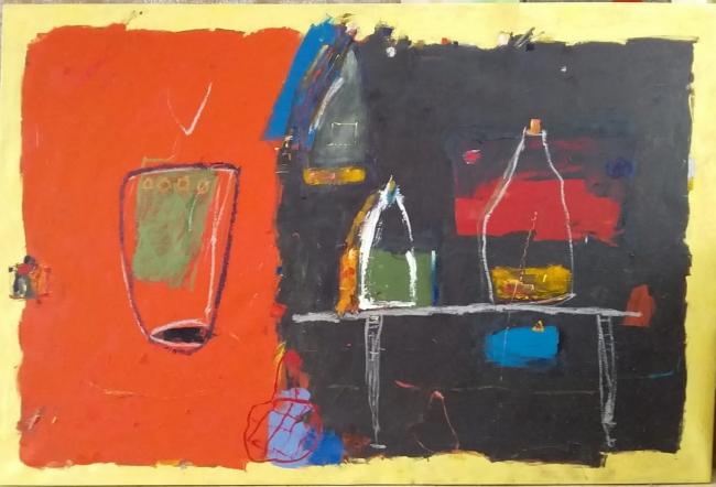 Botellas vaso y mesa